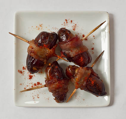 Bacon-wrapped dates. Stuff pitted dried dates with a tamari almond, then wrap with thin slices of bacon. Broil or bake until crispy.