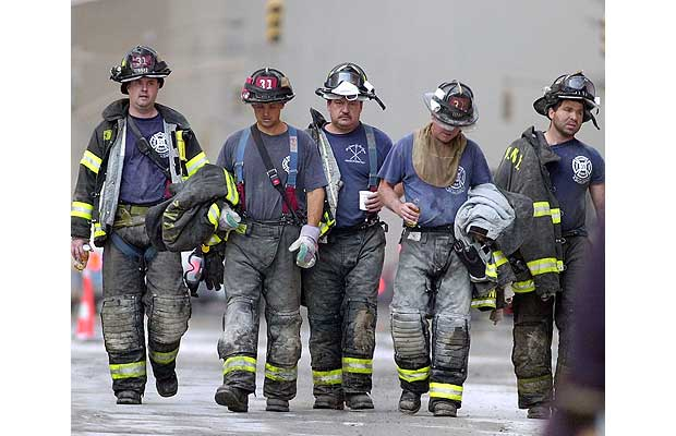 Firemen leave the rescue area near the World Trade Center after their shift, September 13, 2001.