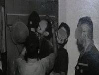 [Photo of French army soldiers torturing Algerian during Algerian War.]