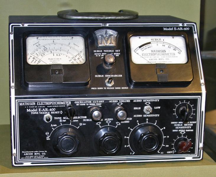[A photograph of a complicated-looking desktop device with knobs, switches, dials, and analog gauges.]