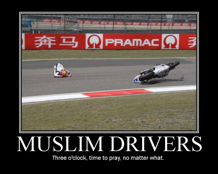 [A photo of an accident in a motorcycle race, perfectly timed and framed with the rider a few metres away from the bike, sliding on the asphalt on his hands and knees in a way that looks exactly like a Muslim at prayer.]