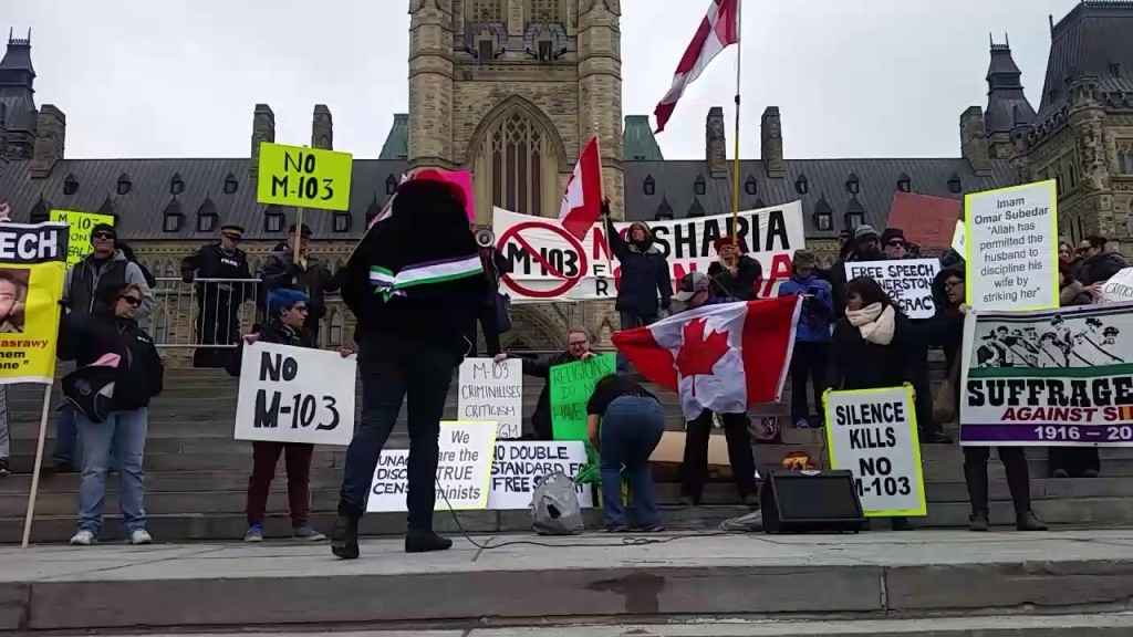 [Photo of M-103 protesters]