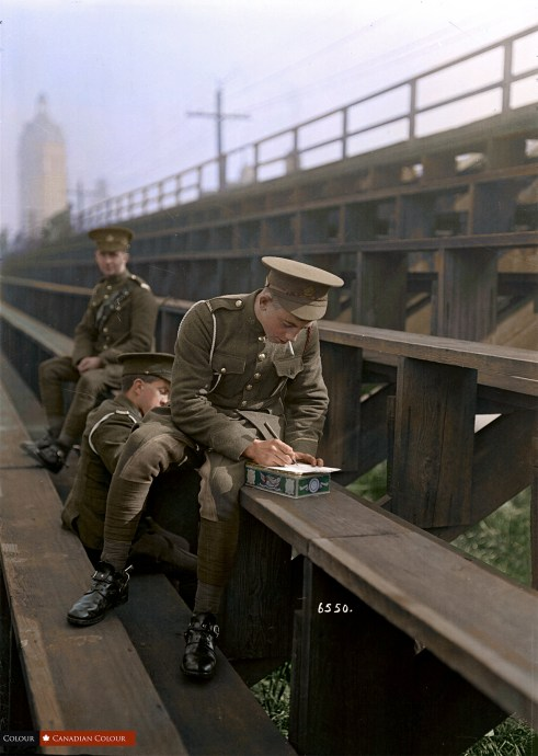 Soldiers writing letters - Colourized Photograph