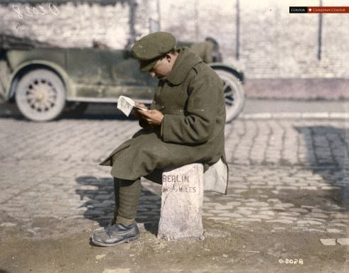 Soldier on a milestone - Colourized Photograph