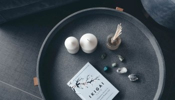 photo of candles stones and book