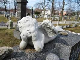 cherub statue at canarsie cemtery