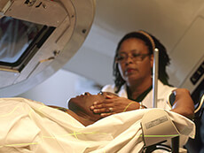 Nurse preparing a patient for radiation therapy