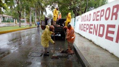 Photo of Limpian y desazolvan registros pluviales de calles y avenidas de Cozumel