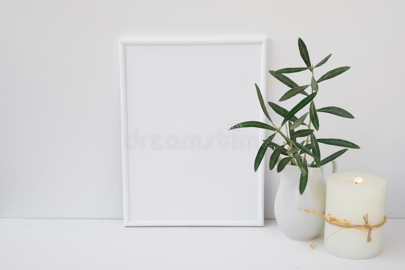 frame mockup on white background olive tree branches in ceramic