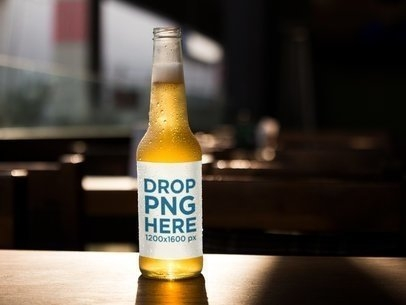 placeit open gold lager beer bottle template on a wooden surface