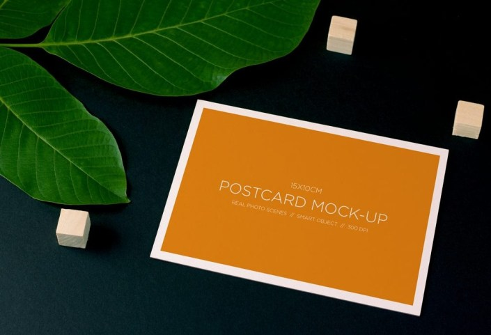 postcard and plant mockup mockupworld