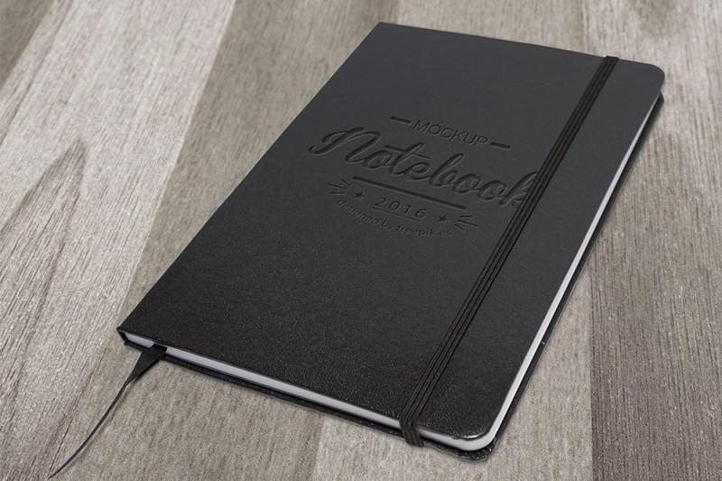 download elegant dark free notebook mockup designhooks
