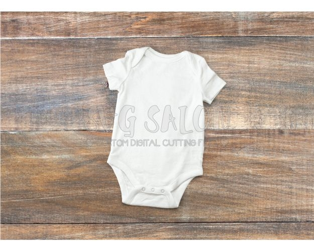 free white ba onesie mockup on wooden background in jpeg