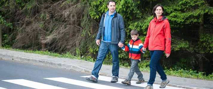 Two People and a Child Crossing Road