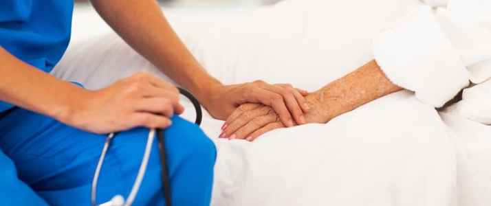 Doctor holding Elderly Persons Hand