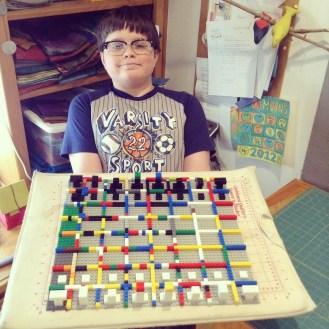 Logan builds a lego chess board!