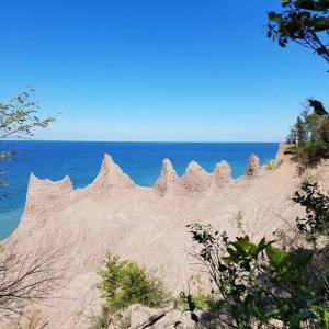 The clay spires of Chimney Bluffs from the woods trail.