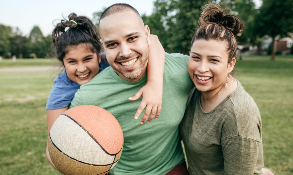 Family of three playing basketball