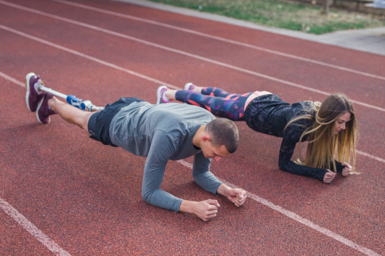 young sports couple on a plank position.