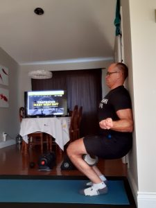 Foam Roller Wall Squat with External Shoulder Rotation