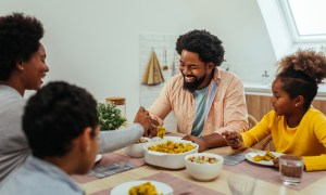 Afro-American family having lunch together at home
