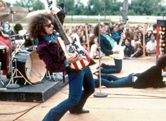 "MOUNT CLEMENS, MI - 1969:  The rock group MC5  (L-R Dennis ""Machine Gun"" Thompson, Wayne Kramer, Fred ""Sonic"" Smith and  Rob Tyner) perform live in 1969 in Mount Clemens, Michigan.  (Photo by Leni Sinclair/Michael Ochs Archive/Getty Images)"