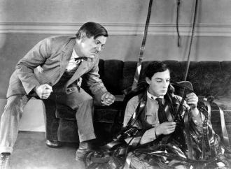 1924: American comedian Buster Keaton (1895-1966) plays a bungling projectionist in the film 'Sherlock Junior', which he also directed.