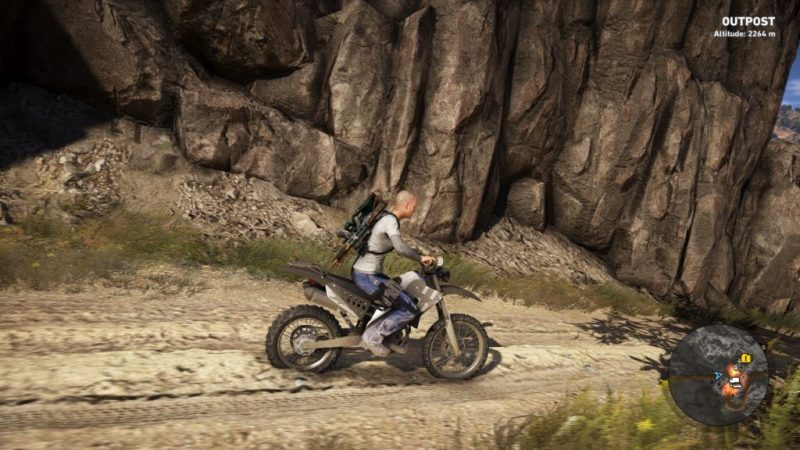 Player riding motorcycle. Minimap shows general vicinity of nearby enemies with orange glow. Minimap also shows icons for collectible intel and vehicles.