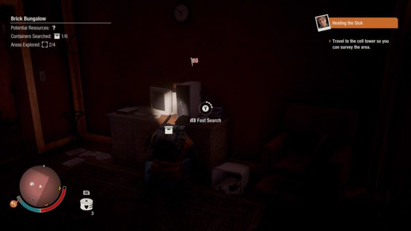 Player character collecting stuff from a desk at night.