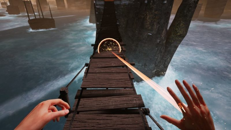 1st person view of hands, right hand shooting beam of light forward onto wooden bridge.