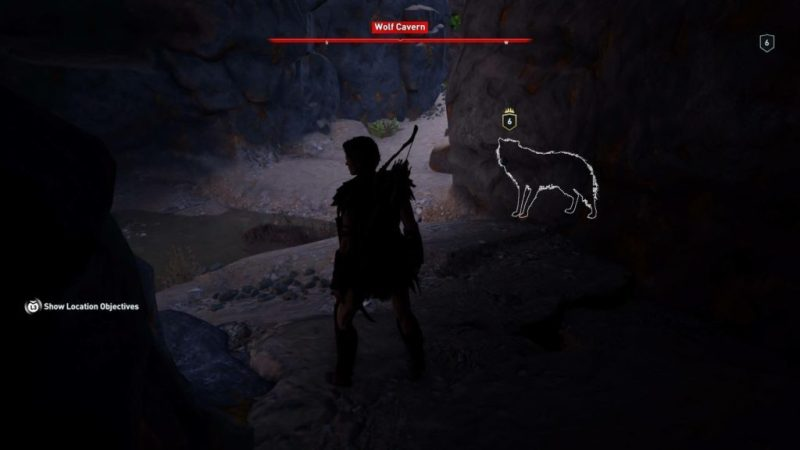 Kassandra inside cave with wolf enemy outlined in white.