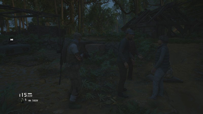 Player character standing near a small group of NPCs having a conversation with no subtitles.