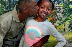 Corvain Cooper with his oldest daughter.