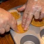 Using a muffin tin to make Marijuana Pumpkin Chesecakes