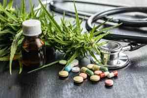 Marijuana buds flowers of cannabis, stethoscope,pills and oil