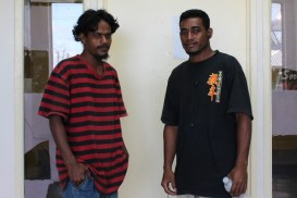 Alumni Coon Anitak, left, was a WAM trainee in 2013 and is now a trainer in MIDB Self-Help building program. At right is Peter Janer, who was in the same training program as Coon and also was hired on by the MIDB Self-Help building program.