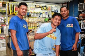 Alumni George Hilai (2013) and Anderson Hampton (2012) with one of their working friend