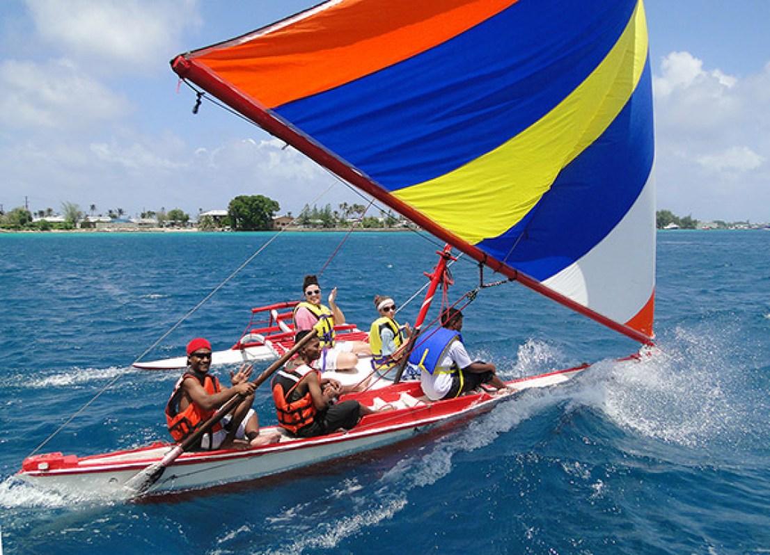 Sailing on a canoe, Brittany Van Auken and Zoe Meyers, ride on a WAM canoe in a Mieco Beach Yacht Club race.