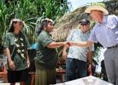 Graduates Mona Tatak and Etmina Mojilong with instructor Ken Taggart and US Ambassador Tom Armbruster. Photo Lois Shelden