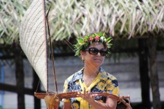 Secretary of Internal Affairs Daisy Momotaro with a model canoe.