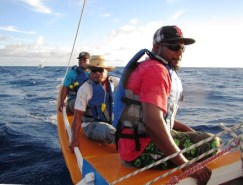 Ejner Aerok, Jason Ralpho, and Sear Helios on the stern of the canoe. Photo: WAM