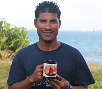 Linton Baso our new Program Manager with a WAM mug. Photo: Tamie Bowman