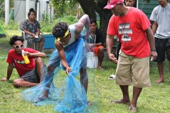 Master Canoe builder Binton Daniel teaching Atnel Tabu throw netting. Photo: Sealand Laiden