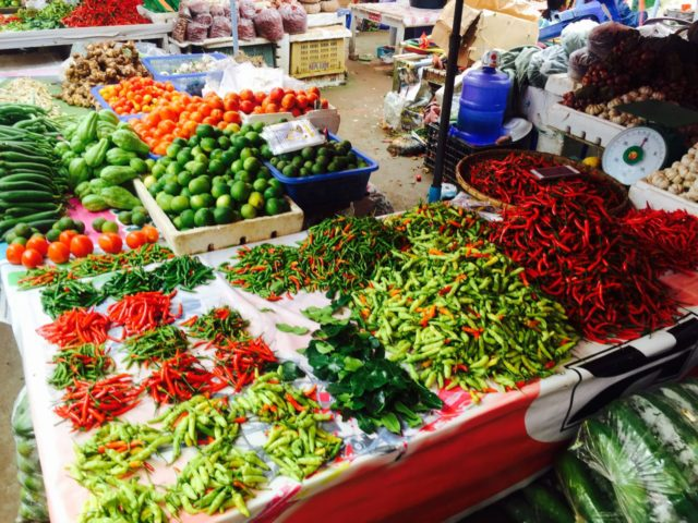 Luang Namtha morning Market, Laos - piles of colourful chillies