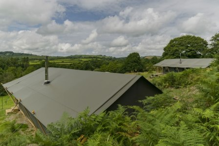 A view over the tents showing Afon and Aderyn and the valley beyond