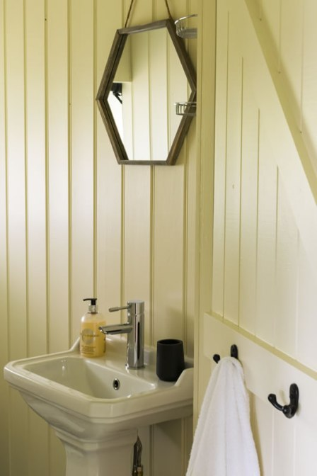 An image of the private flushing toilet and cloakroom in our luxury tents