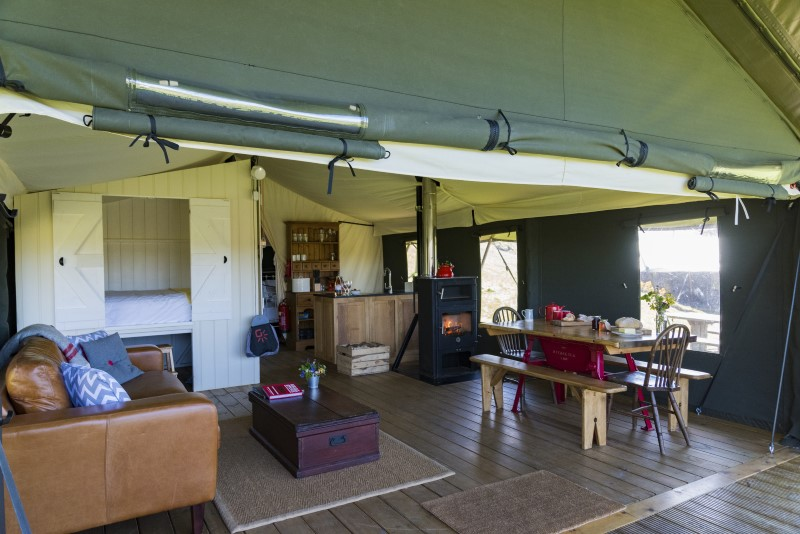 A view of the living area of the safari tent with the front up