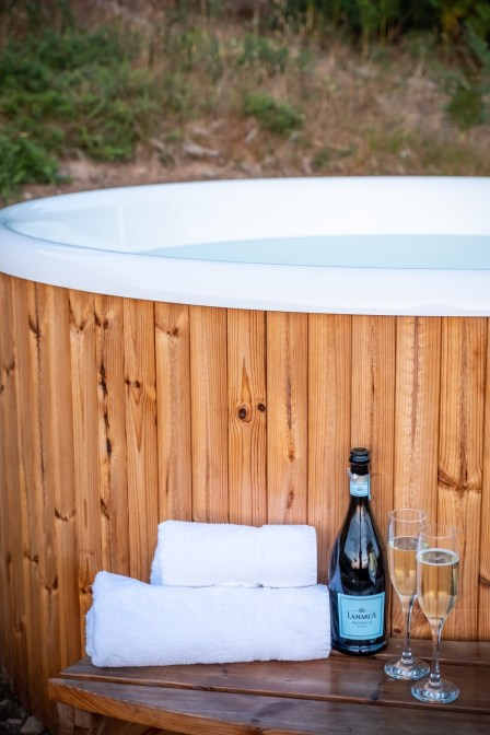 The hot tub ready with prossecco, glasses and towels