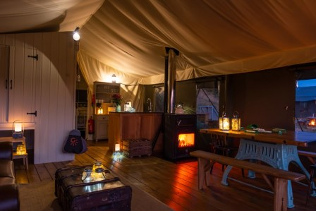 The inside of Afon safari tent at night
