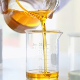 CBD oil pouring into beaker